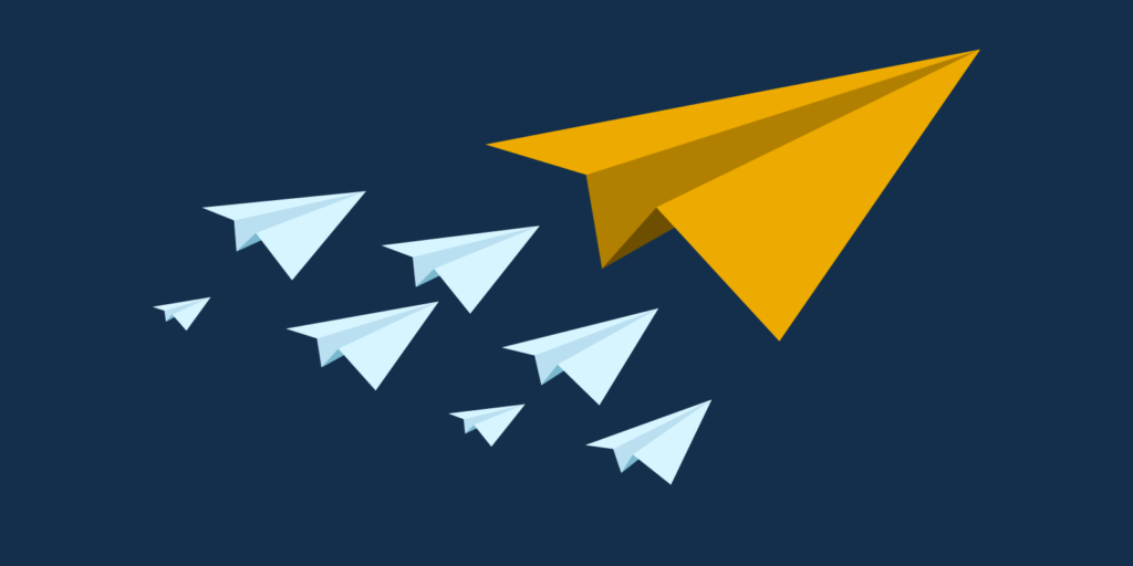 Small blue paper airplanes following a larger orange paper airplane on a navy blue background representing charismatic leadership theory.